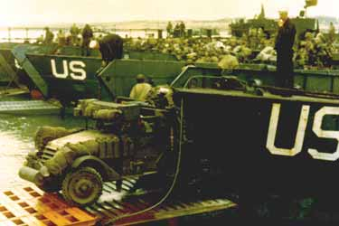 Photo, Trucks are being loaded onto an LCT in a British port
