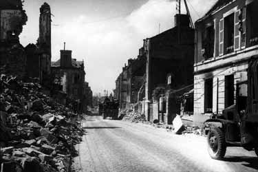 Photo, Members of the 1st Bn, 355th Engineers, cleaning through wrecked streets of St Lo so that traffic could move by road from Omaha beach