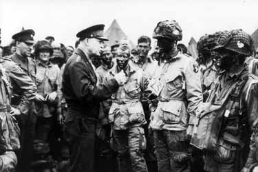 "Photo, Gen Dwight D Eisenhower gives the order of the Day. ""Full victory - nothing else"" to paratroopers in England, 6 June 1944"