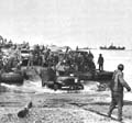 Rhino ferry discharging ordnance troops and supplies on a 