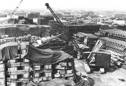 Photo:  Engineer crane stacks lumber at Thatcham, April 1944