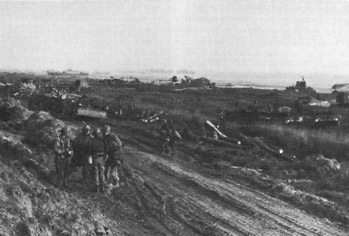 Photo:  Roads leading off the beaches opened by engineers, 8 June 1944