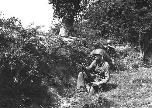Photo:  Infantrymen in action in the Hedgerows