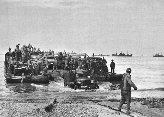 Photo:  Rhino ferry discharging men and supplies on a Normandy beach