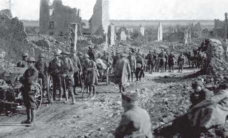 Troops of the 18th Infantry passing through St. Baussant, France, in advance on St. Mihiel front, 13 September 1918
