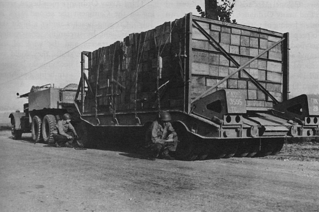 Photo:  A tank transporter hauling ammunition, France